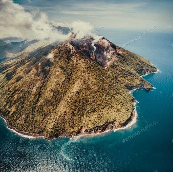 Fog over Indonesian volcano. Aerial drone shot