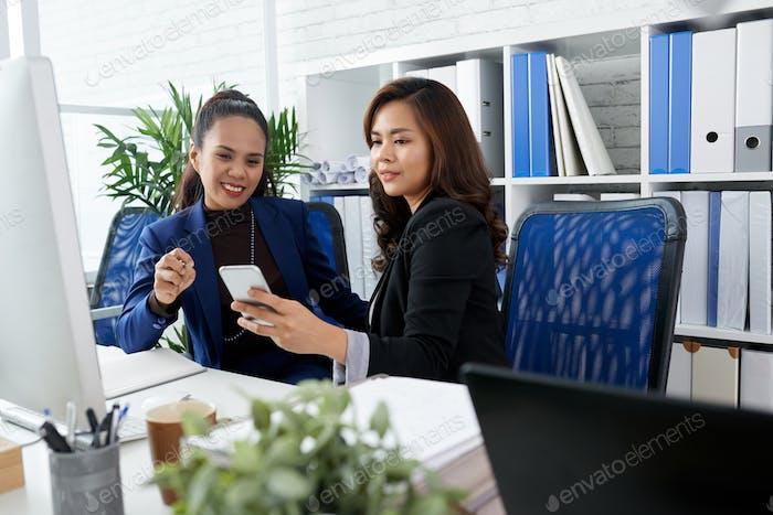 Female Entrepreneurs Discussing Text Messages