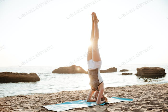Portrait of a strong woman doing fitness exercises outdoors