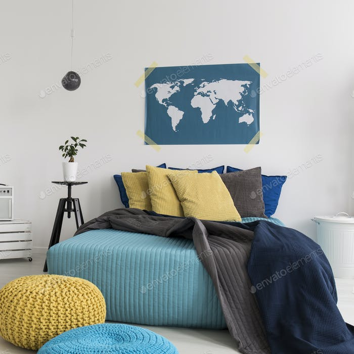 Blue and yellow bedroom with bed