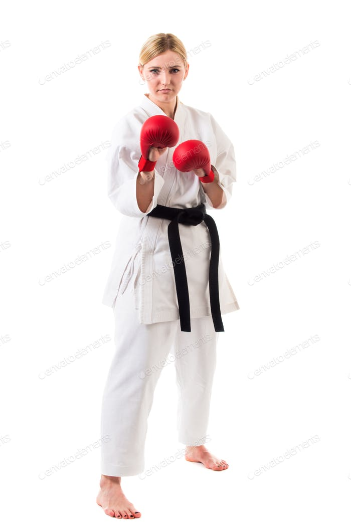 Girl in kimono for karate and boxing gloves