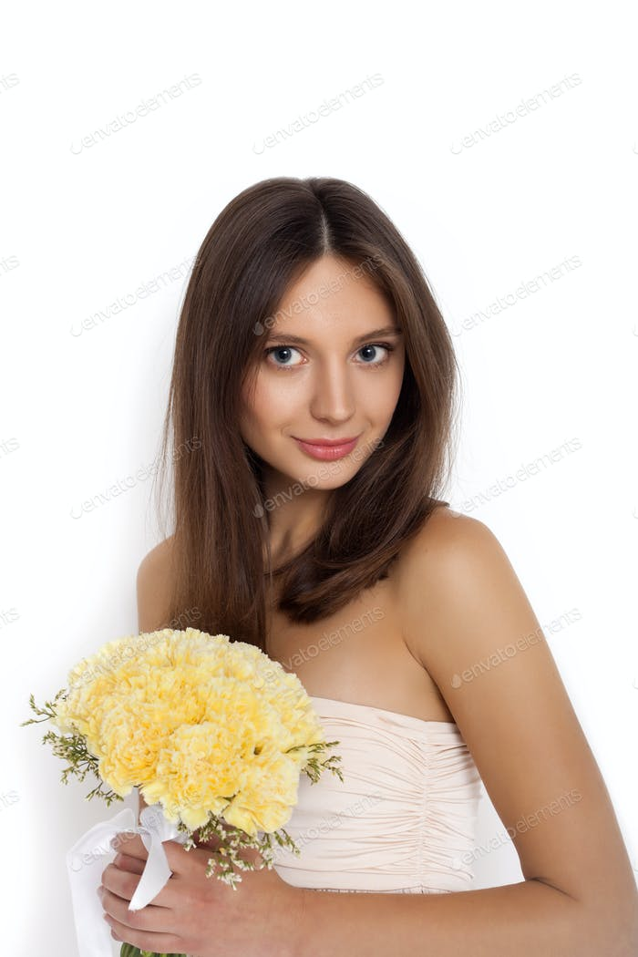 Young cute woman with spring flower bouquet