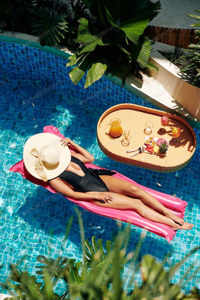 Young Woman in Bikini and Straw Hat