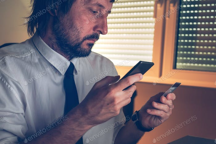 Businessman using mobile banking services app to purchase online