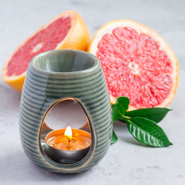 Aromatherapy lamp with grapefruit essential oil, copy space, square