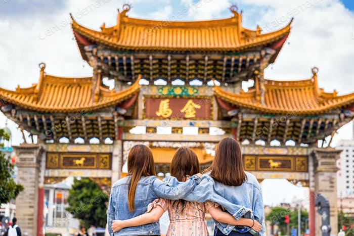 back side of Three asian happiness women walking and sightseeing together when travelling