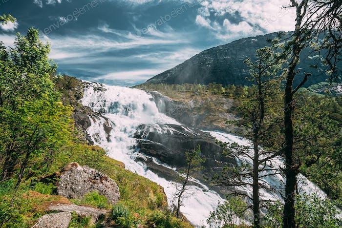 Kinsarvik, Hordaland, Norway. Waterfall Nyastolfossen In Hardangervidda Mountain Plateau