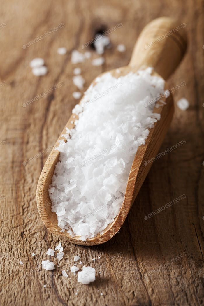 sea salt in wooden scoop