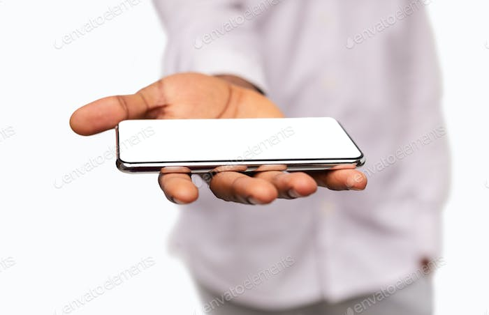 Man holding modern smartphone with blank screen on open palm