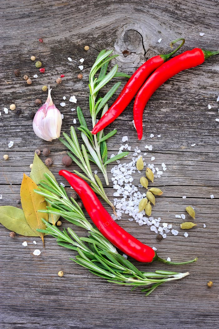 Vegetables and spices on wooden background. Chili, rosemary, sal