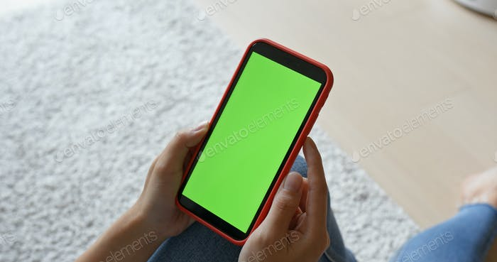 Woman hold with cellphone with green screen