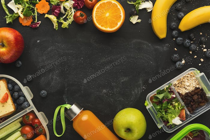 Fruits and vegetables assortment on black background with copy space