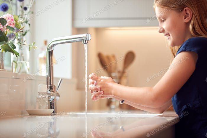 Girl Washing Hands With Soap At Home To Prevent Spread Of Infection In Health Pandemic