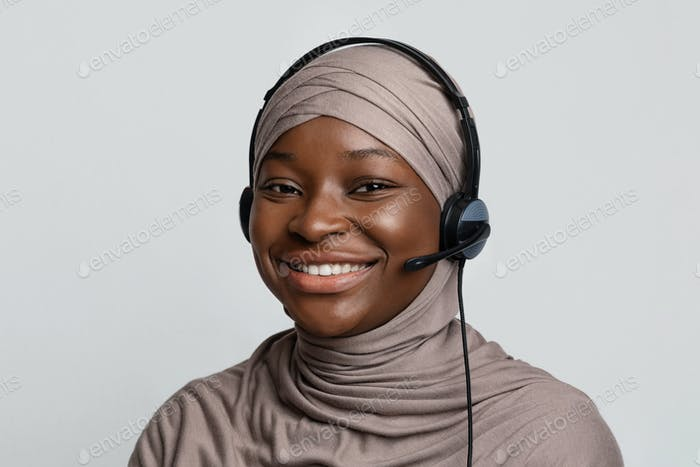 Portrait of black muslim call center operator lady in hijab and headset