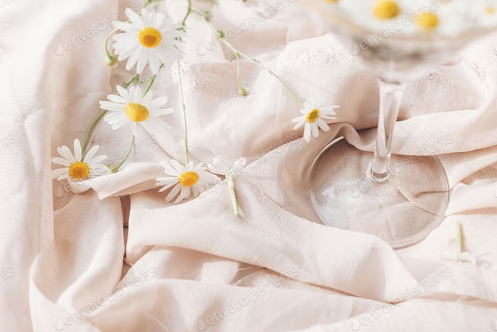 Daisy flowers and white wildflowers at wineglass