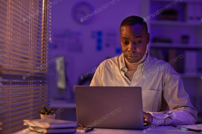 African American Man Working In Evening