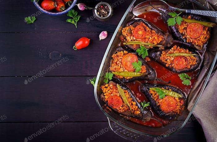 Karniyarik - turkish traditional aubergine eggplant meal. Stuffed eggplants with ground beef