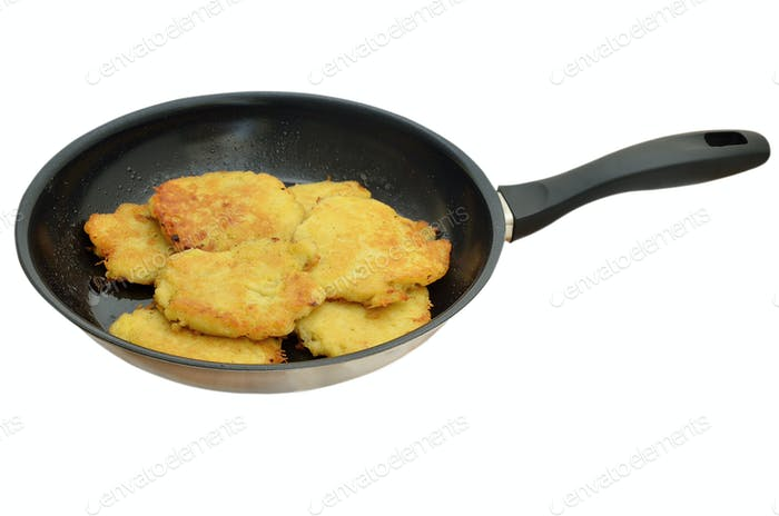 Hot potato pancakes in a pan