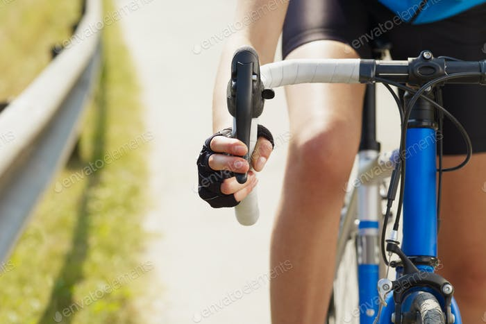 Cropped View Of Female Cyclist Holding Break Of Bike