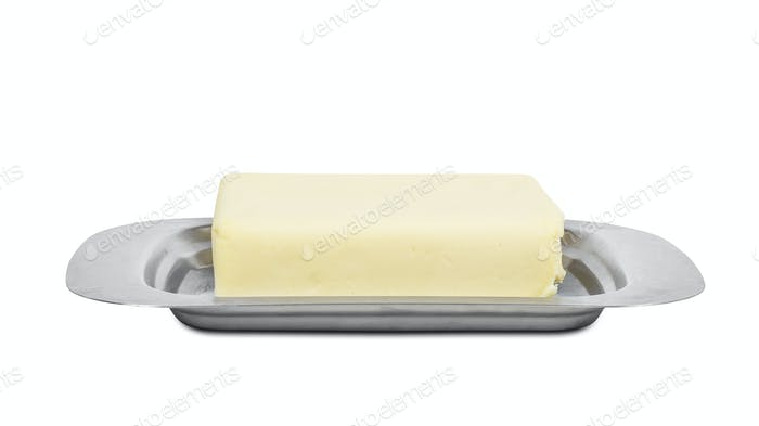 Piece of butter in metal box on white background