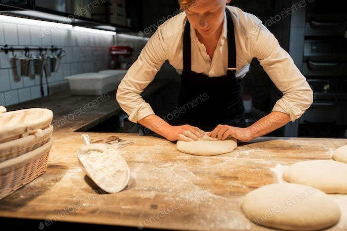 chef or baker making dough at bakery