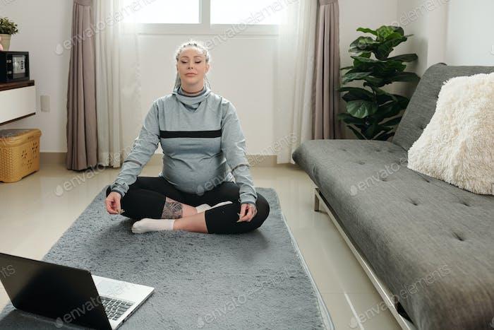 Pregnant woman following tutorial