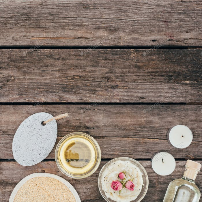 top view of oil, salt, pumice and spa treatment on wooden table