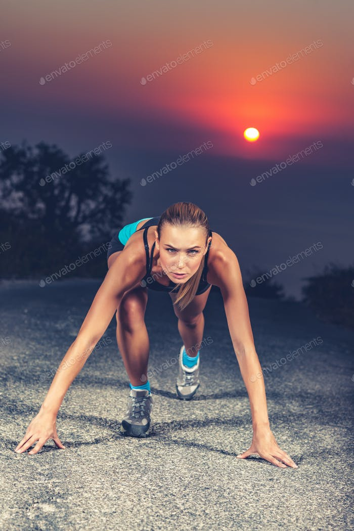 Sprinter woman on the start