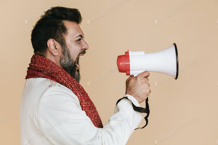Indian man screaming into a megaphone