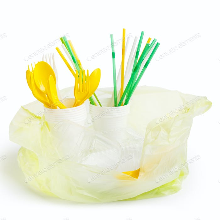 Plastic bag full of plastic utensils