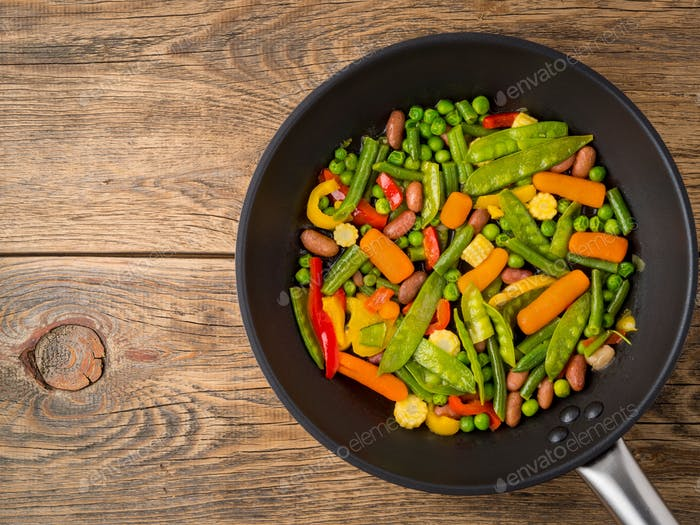 big pan fried with colorful vegetables