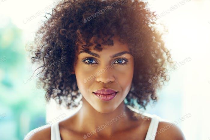 Charming black woman looking at camera