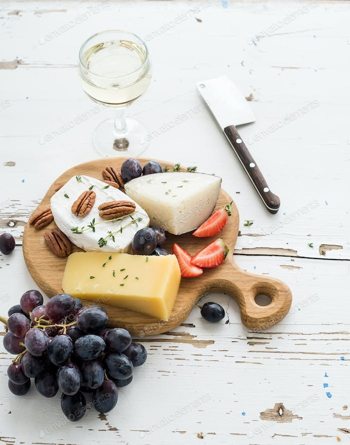 Cheese appetizer selection or wine snack set. Variety of cheese, grapes