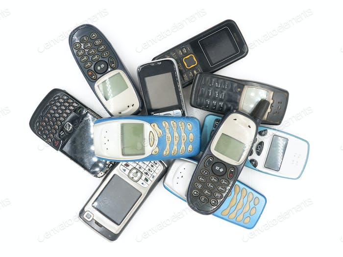 Top view of Old mobile phones on white background