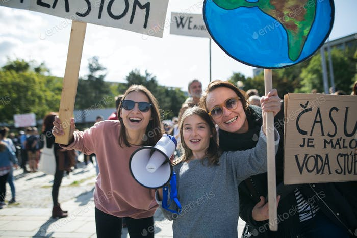 People with placards and amplifier on global strike for climate change