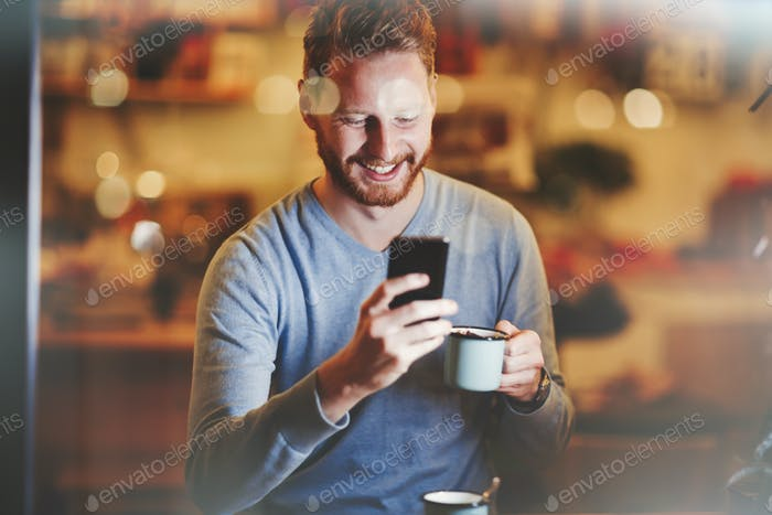 Cheerful businessman drinking coffee