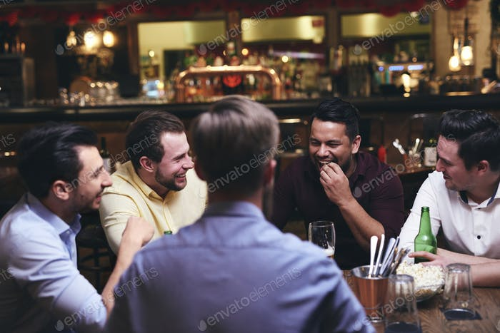Group of friends enjoying time together in the pub