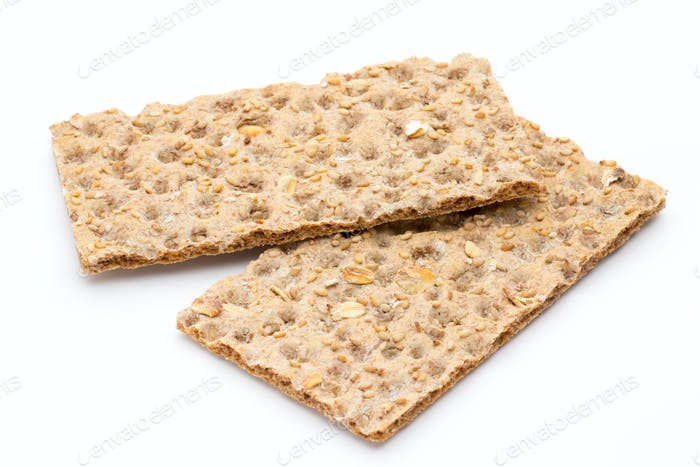Stack of wholegrain crispy bread with sunflower, chia and sesames seeds