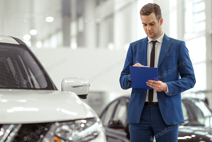 Businessman in motor show