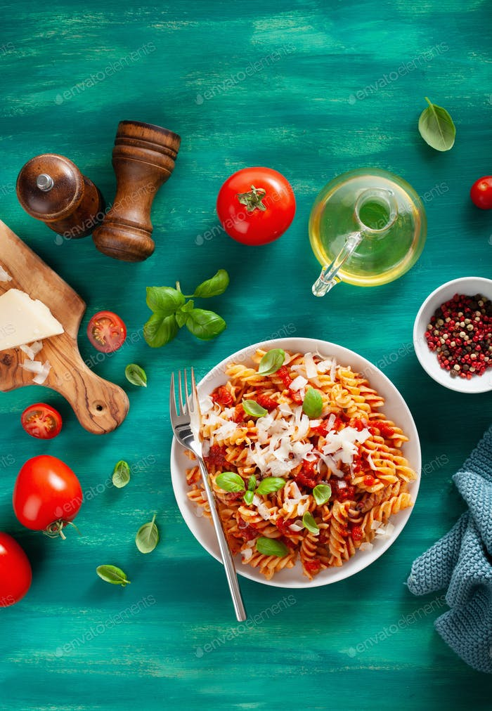 healthy fusilli pasta with tomato sauce parmesan basil
