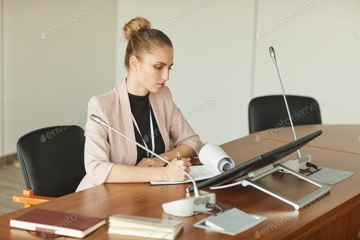 Female leader sitting at conference table