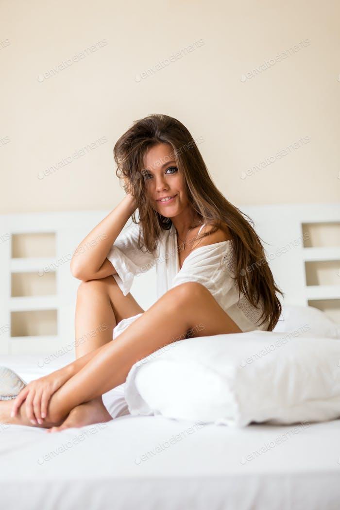 Young beautiful female wake up.