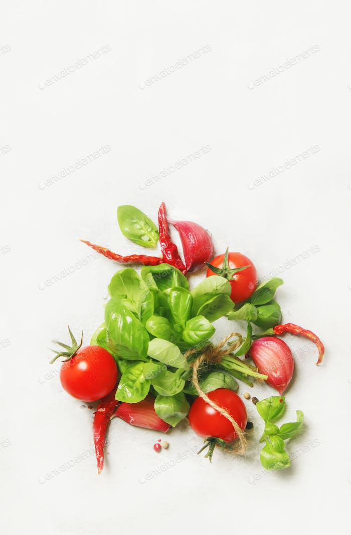 green basil and red cherry tomatoes