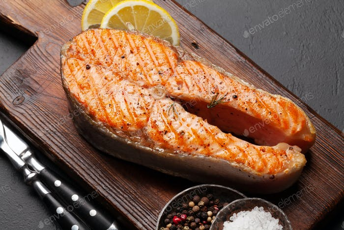 Grilled salmon steak. Fish steak with herbs and spices