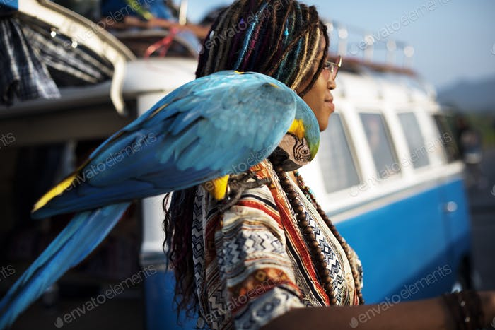 Woman with Parrot on Shoulder Standing by The Van