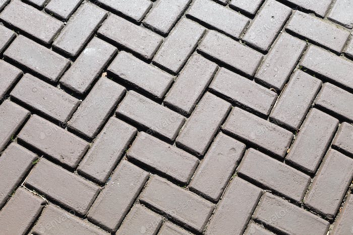 Dark gray brick pavers.