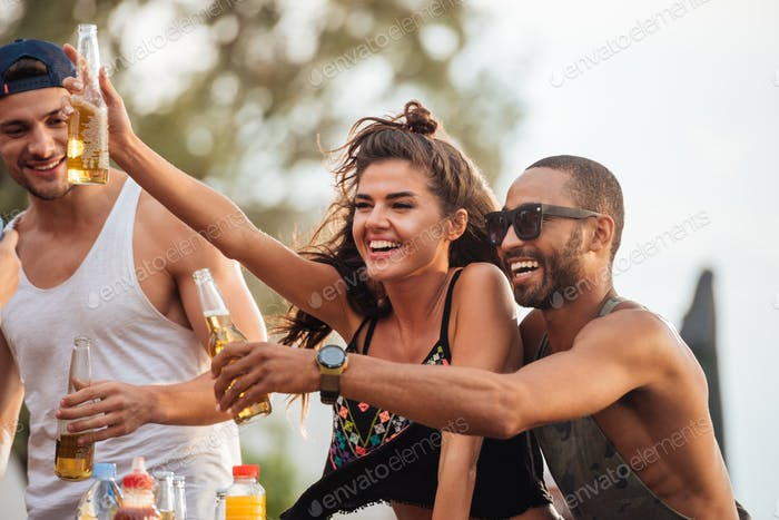 Friends drinking beer and having fun outdoors