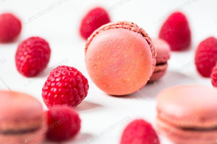 Raspberry Macaroons with Raspberries on Light Background
