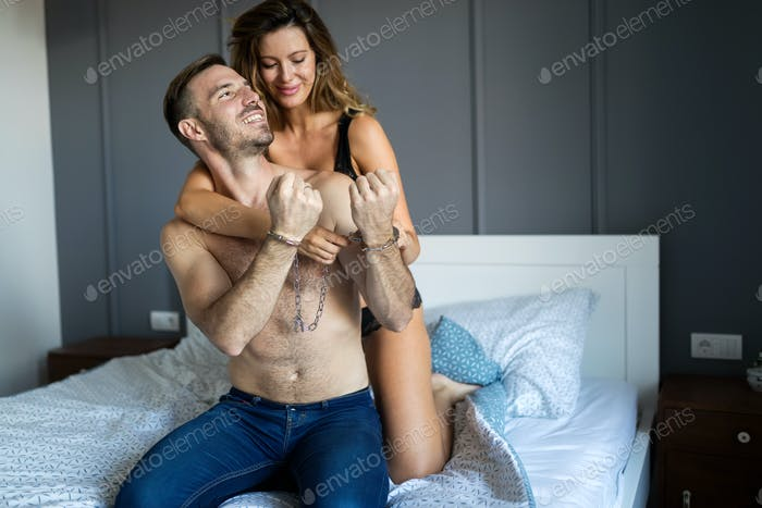 Couple doing a sex game in bed