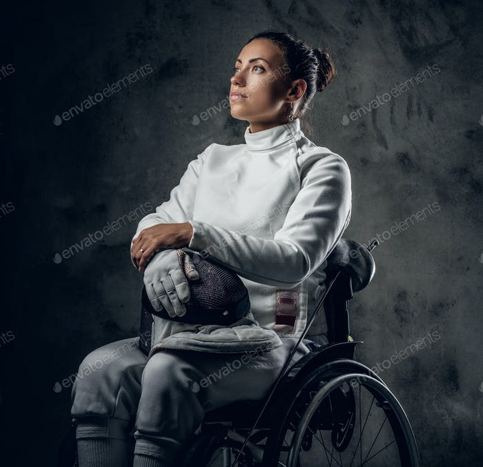 Female fencer in wheelchair with safety mask and rapier.